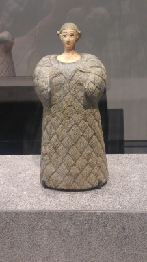Woman dressed in woolen garment: This majestic statuette is probably an important deity in Central Asian mythology. She is seen on other representations in which she appears to pacify the powerful forces of nature. Oxus civilisation; Central Asia, Bactria, 2300 – 1700 BCE