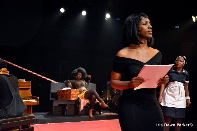 Busi Lurayi as Nina Simone surrounded by the rest of the cast.