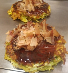 Okonomiyaki, the savoury pancakes cooked on a flat grill