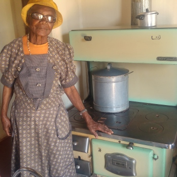 Besie Mogapi shows off her stove with pride