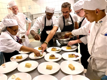 Chef Victor Lucas plating with Prue Leith students